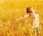 15238304-Picture-of-cheerful-teenager-having-fun-in-countryside-cute-happy-female-standing-on-wheat-field-wit-Stock-Photo